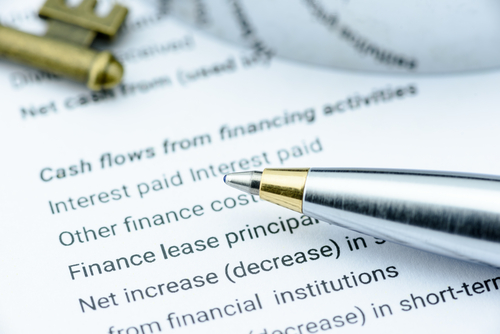 paper and pen with important banking and finance terms